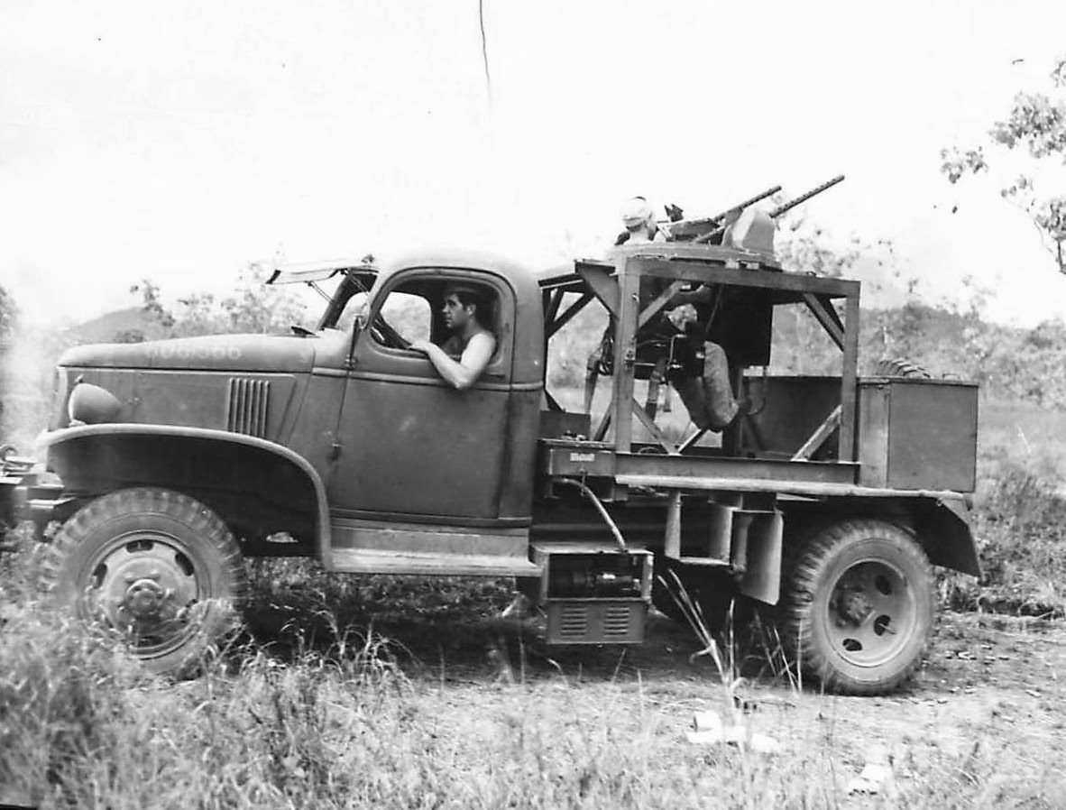 U.S. troops in a Chevrolet E-5 turret training truck in New Guinea, 1943