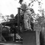Troops in Chevrolet G506 E-5 turret training truck in New Guinea