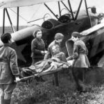 Wounded Russian soldier being loaded onto a Polikarpov U-2 / Po-2 ambulance plane by nurses