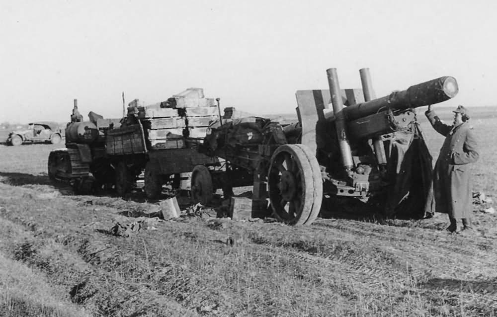 Stalinetz S-60 artillery tractor towing gun