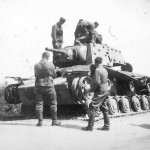 German soldiers examining destroyed KV-1 tank with extra armor