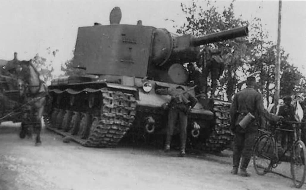 German soldiers inspecting KV2 tank