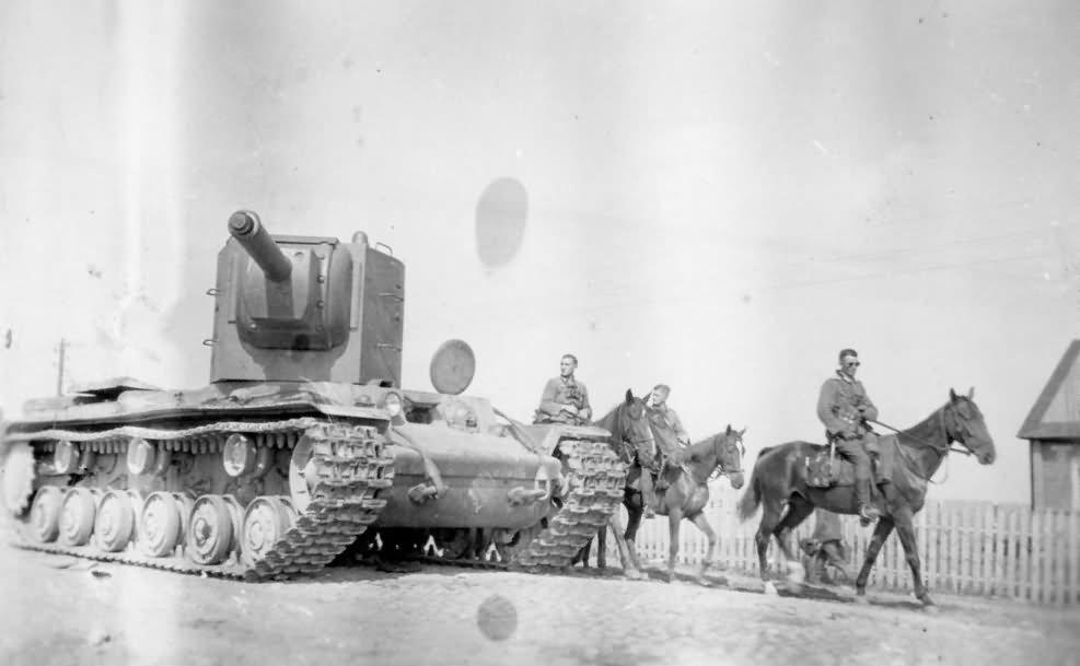 Heavy assault tank KV-2 and german Wehrmacht cavalry
