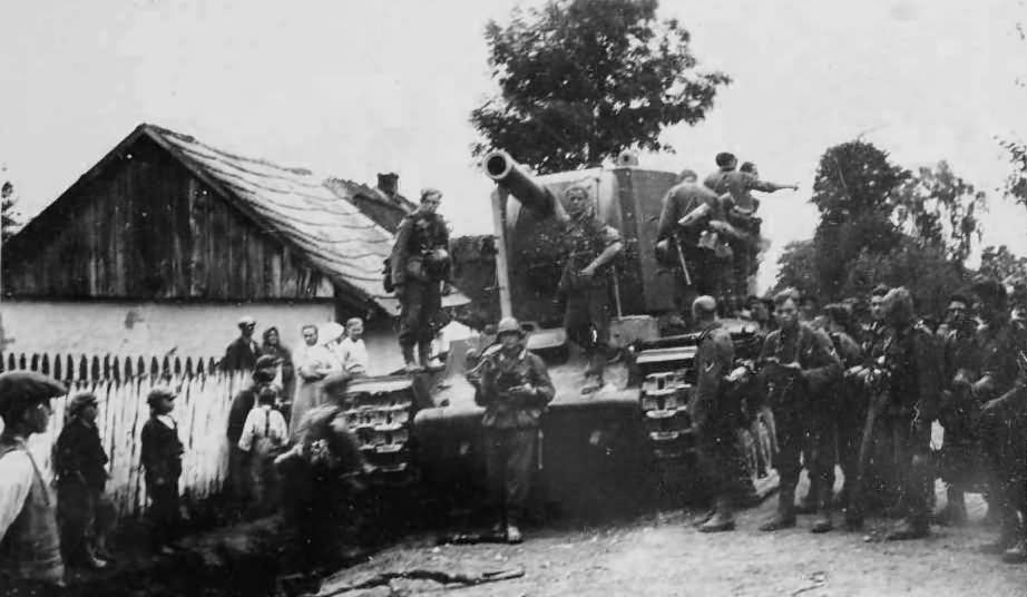 German soldiers examining knocked out heavy tank KV2 – Eastern Front 1941 Operation Barbarossa