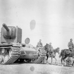 Heavy assault tank KV-2 Kliment Voroshilov and german Wehrmacht cavalry