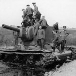 German soldiers examining knocked out heavy tank KV2