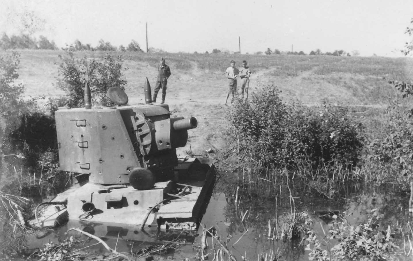 KV-2 tank model 1940 with early turret stuck in a muddy river bed