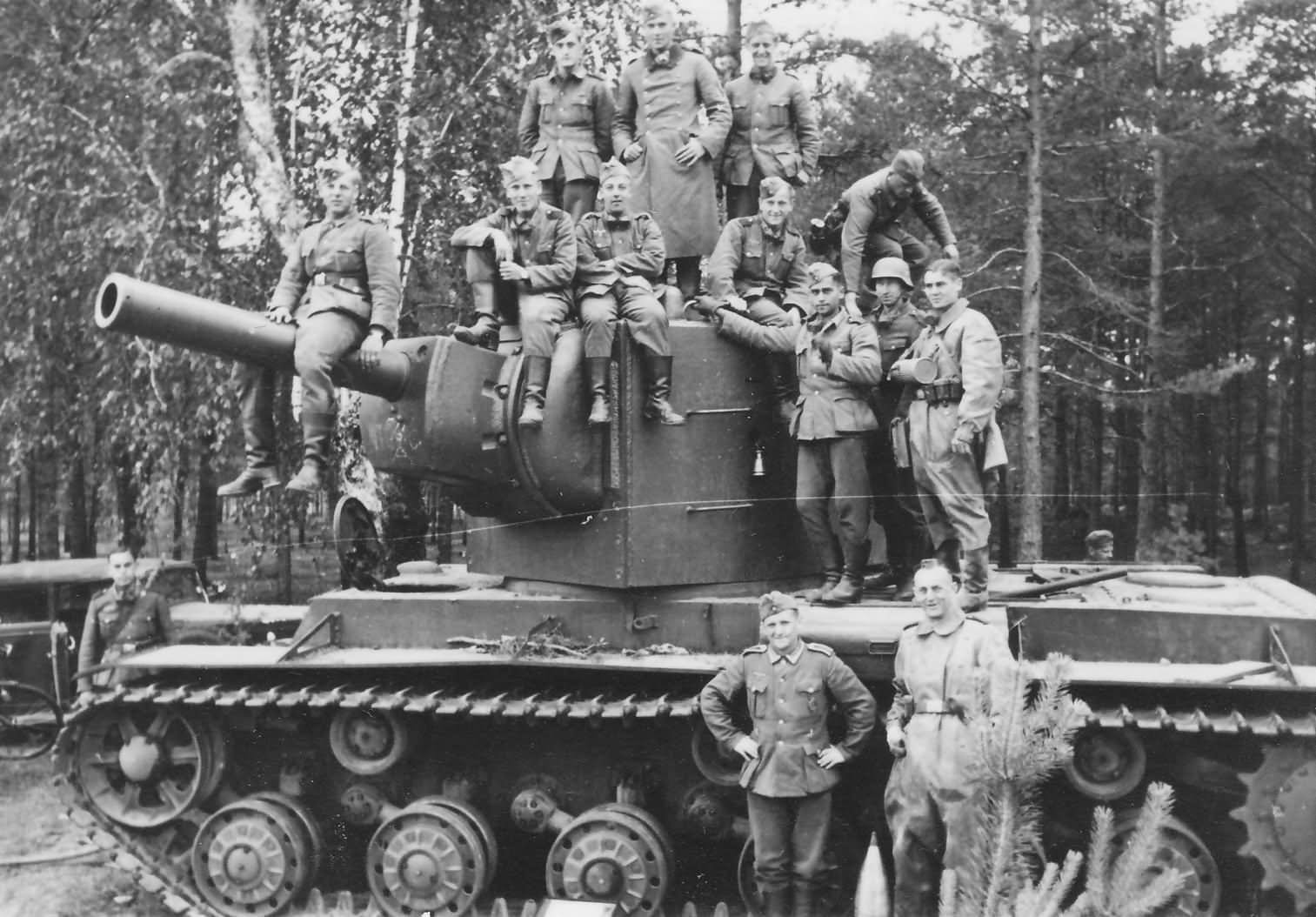 Heavy tank KV-2 (late) and wehrmacht soldiers