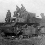 German troops pose next to a captured and destroyed T-28