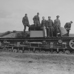 German troops pose next to a captured and damaged T-28