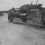 T-28. German troops of the 12. Panzer-Division have painted their insignia on the tank as a road sign for the location of their encampment.