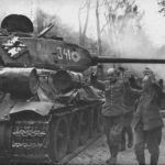 T-34/85 of the 7th Guards Tank Corps and German POW Berlin 1945