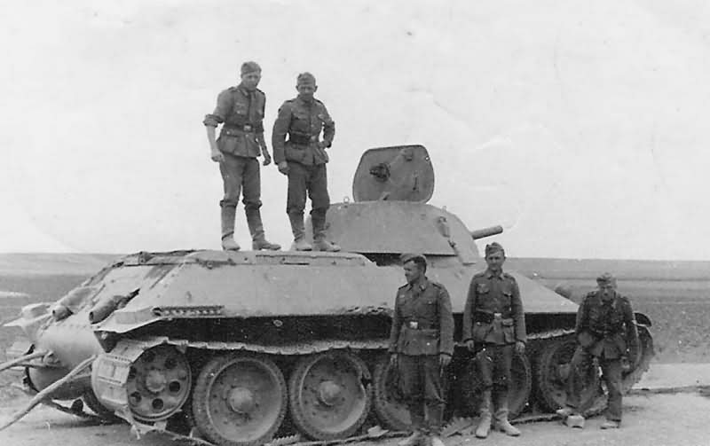 Early T-34/76 and wehrmacht soldiers