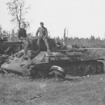 A german soldiers sit on the front of a captured T-34 tank. Meschew Eastern Front 1941