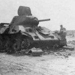 Early T-34 76 knocked out on the roadside during the fighting in Ukraine in 1941