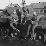 wehrmacht soldiers next to T-34 mod 1941