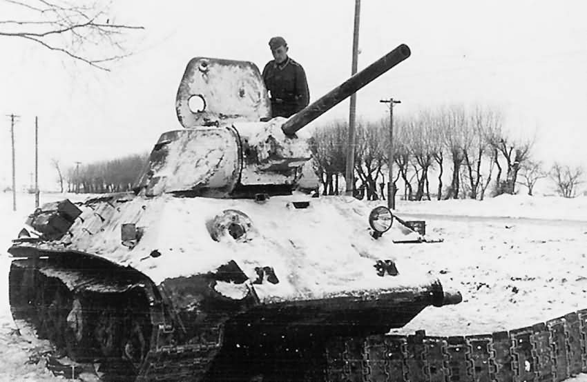 destroyed soviet T-34/76 mod 1941 tank winter
