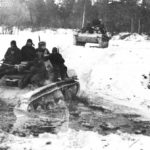 Russian troops riding on the T-60 tank