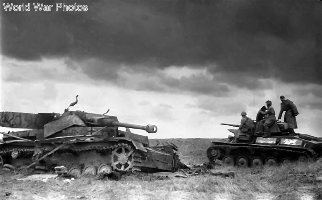 T-70 tank passes a blown apart german Panzer IV Ausf G Summer 1943