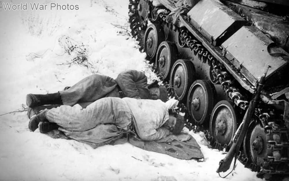Tank crew sleep near their T-70